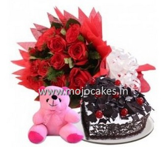 black forest cake with 10 red roses and a teddy bear